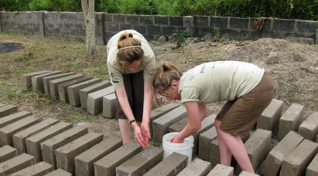 An important part of building volunteer work in Ghana is to prepare building materials.